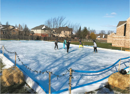 neighbours were able to connect outside on the rink at mountainview church during the pandemic