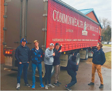 london christian high school students at work on the shipping container